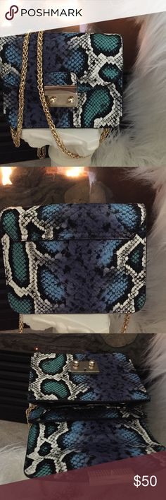 TopShop Cross body bag Perfect small bag to carry essentials for day or night! Gold chain can also be tucked inside for use as a clutch.  Great bag and so in style right now! Blue multi color with fold over top that clasps. NWOT Topshop Bags Crossbody Bags