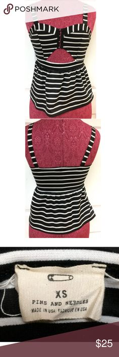 Pins & Needles Black & White Striped Tank X-Small For sale we have an Urban Outfitters Pins & Needles black and white striped sleeveless tank top size XS. It has a snap up front and a cut out. Please view all pictures. No stains or tears.   Approximate measurements: Chest: 26 inches around Length shoulder to hem: 21.5 inches Urban Outfitters Tops Tank Tops