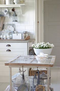 Island made from an old window and cart -- love it all and especially love the white bowl full of white flowers!