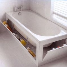 The built in cabinet surrounding this tub provides enough space for extra cleaning sponges, shampoo, and soap. http://hative.com/diy-bathtub-surround-storage-ideas/