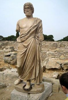 The statue of Aesculapius, god of medicine, at the remains of his Greek temple at Empúries, Spain.