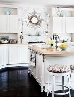 Love this kitchen....dark floors and white cabinets