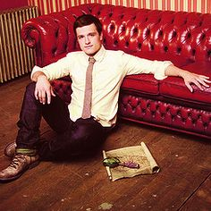 That red couch is to die for...and the hot dude sitting on the floor next to it isn't half bad either.