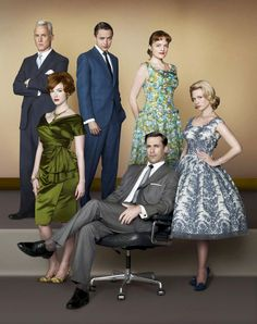 "Actors (back row) John Slattery, Vincent Kartheiser, Elisabeth Moss (front row) Christina Hendricks, Jon Hamm and January Jones of ""Mad Men"" posed for the promo shot for season 2 in outfits from 1962, with the women in fitted puffy mid-length dresses and the men in suits."