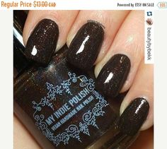 This polish was made for a special show we did in Toronto. We wanted to also make it available to those who could'nt make the show. TBOTB is a holographic dark chestnut brown/black with red microglitter   Pics provided by Beautybybekk on IG  Shown with topcoat    We are a small family run company that takes our lacquer addiction seriously.      We make tons of unique polishes including   Cremes  Glitters  Duo and Multi Chromes  Holographic  Glow in the dark  Thermal  Solar    I'm Tanya! I'm…