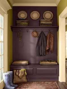 Much less labor/materials needed for this kind of 'mudroom' wall...hooks, shelving and drawers (or could be another shelf with baskets beneath) ~ all painted the same color, it reads as a built in unit.