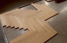 Parquet flooring blocks being assembled