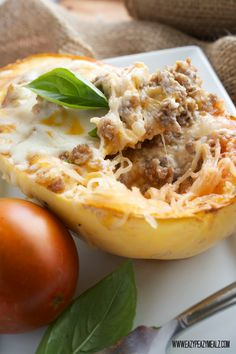 Spicy Sausage Lasagna Spaghetti Squash: A fantastic way to have a low carb lasagna dinner with half the work of traditional lasagna. Healthy, easy, and full of flavor this quick dinner is sure to please. - Eazy Peazy Mealz