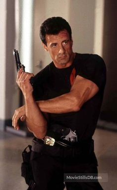 A gallery of Demolition Man publicity stills and other photos. Featuring Sylvester Stallone, Wesley Snipes, Sandra Bullock, Marco Brambilla and others. Sylvester Stallone Young, Silvestre Stallone, Art Football, Rocky Series, Marvel Comics, Punisher Marvel, Demolition Man, Just Beautiful Men, Actors Male