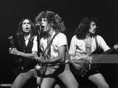 Photo of Alan LANCASTER and Rick PARFITT and Francis ROSSI and STATUS QUO, L-R: Francis Rossi, Rick Parfitt, Alan Lancaster performing live onstage