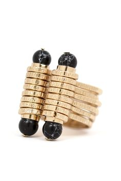 The Substation Ring highlights four black and white crackled beads sitting atop two bars wrapped in textured bands. It's a statement piece you'll go back for again and again! mooreaseal.com