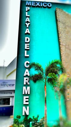 "A sign near the Cozumel ferry pier that reads, ""Playa Del Carmen, Mexico."""