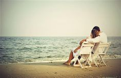 Romantic Couple Seating on Beach Wallpaper Download