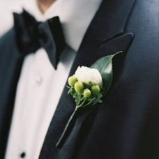 Chad's green & white boutonniere from our wedding
