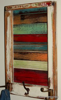 Old window frame repurposed.... cool idea for a boy's room or even mud room. Love the bright coloured wood slats