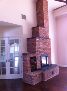 Masonry Heater Fireplace by Empire Masonry Heaters. This was done in San Diego CA Owner Jan Carr