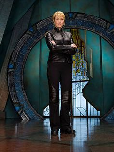 """Brigadier General Samantha """"Sam"""" Carter, USAF is a fictional character in the Canadian-American military science fiction Stargate franchise. Played by English-Canadian actress Amanda Tapping she appears in all three shows in the franchise: Stargate SG-1, Stargate Atlantis, and Stargate Universe"""