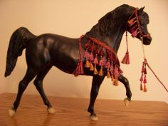 CM Breyer or Peter Stone Arabian costume halter presentation set - burgundy, magenta, and gold mixed with metallic threads on Breyer Black Stallion 401 - I rarely work with the volume of metallic threads seen in this set, but I'm always pleased with the results when I wrestle those pesky shiny threads into submission!