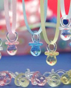 """Ready for some baby shower fun? Turn these baby pacifier necklaces into a baby shower game we like to call the Don't Say """"Word"""" baby shower game—the word is up to you!"""