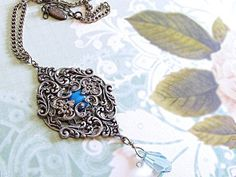 $55  Romantic filigree necklace with genuine Turquoise stone abd layers of Victorian style filigrees. Swarovski Crystal dangles beautifully from the bottom.