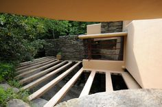 Fallingwater/Edgar Kaufman House / 1413 Mill Run Road, Mill Run, Pennsylvania / 1936-1939 / Frank Lloyd Wright -- A passageway (with walkway below) is covered with horizontal beams, part of Wright\'s design philosophy of using mainly vertical and horizontal lines