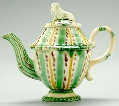 A late 18th century Whieldon tortoise ware teapot having a double cone form