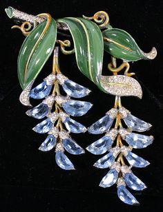 Trifari enamel and rhinestone flower brooch with hinged dangling blue wisteria blossoms