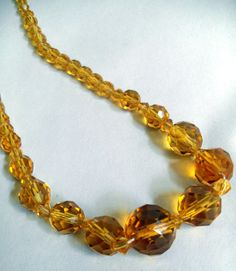 "B8985 £20 or offer INC POST. A vintage amber coloured graduated and faceted glass bead necklace measuring approximately 16.25"" long (including the barrel clasp). Exact age unknown. Weighs just over 26g."