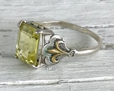 Vintage 14k Gold and Sterling Silver 2 CT Citrine Fleur de Lis Ring Size 7.75 by AdornedInHistory on Etsy