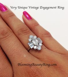 #ExtremelyUniqueVintageEngagementRing http://www.BloomingBeautyRing.com