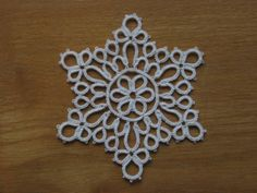 snowflake 14 (slightly adjusted) from 24 snowflakes in tatting, Lene Bjorn, anchor aïda 20, by Marietje on InTatters