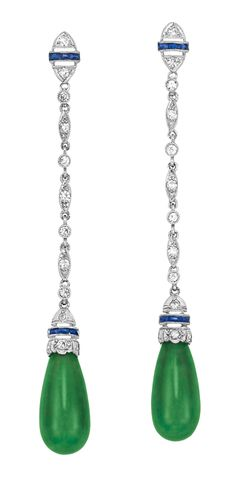 Pair of Art Deco Platinum, Diamond, Sapphire and Jade Pendant-Earclips   Topped by pierced diamond-set navette-shaped panels accented by a band of 6 rectangular-cut sapphires, joined by a delicate chain of alternating diamond-set navette-shaped links and collet-set diamonds, suspending 2 drop-shaped jades approximately 12.5 x 6.1 mm., capped by scalloped edge tops set with 4 single-cut diamonds, centering a slender band of 6 sapphires, circa 1920. [Cross posted from Jade and Jadeite]