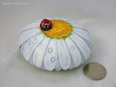 Painted rock,painted stone,white daisy,gerbera daisy,lady bug,flower painted rock,daisy stone,garden decor,daisy flower,rock art,lady bird by NightOwlFineArt on Etsy https://www.etsy.com/listing/549297985/painted-rockpainted-stonewhite