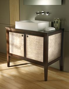 Beautifully handcrafted of fine hardwood, this vanity is available in four sizes, with various finishes and panel treatments.   2011 ADEX Silver Award Winner