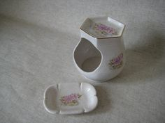 I believe these were originally part of a bathroom set, and are a soap dish and cotton wool holder. However they could easily be used in the kitchen as