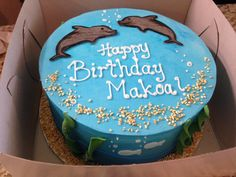 This cake was was a special design for a little boy's birthday charter over the 4th of July weekend! Super Cute!   www.tradewindcharters.com  #Hawaii #Oahu #charter #vacation #cruise #birthday #celebration #family #dolphin #cake #sea