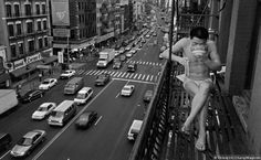Fire Escape. A newly arrived immigrant eats noodles on a New York fire escape, 1998