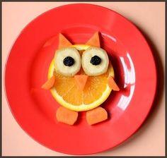 Food arranged like an owl; could use kiwi instead of carrots