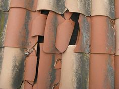 close up on broken roof tiles
