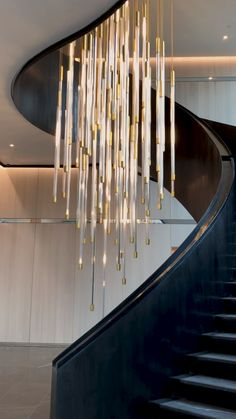A sculptural lighting installation composed of 75 bespoke illuminated pendants, hung over a stunning spiral staircase linking both floors of the main atrium at Foster + Partners Prinicipal Tower development. A constant stream of cascading light falls within glass tubes, suggestive of a flow of data or a light rainfall, and symbolic of the bustling London business district outside.⠀  #lightinstallation #luxurylighting #modernchandelier #chandelierlighting #staircaselighting Luxury Chandelier, Contemporary Chandelier, Luxury Lighting, Custom Lighting, Chandelier Lighting, Lighting Design, Glass Chandelier, Luxury Staircase, Staircase Design