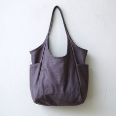This luxe roomy tote has a simple ease. Minimal clean lines, lightweight and soft, with waxed canvas pockets, in rugged Italian and American leathers. Minimal Tote with matching clutch Premium veg tan Leather Crossbody, Leather Bag, Urban Bags, Soft Leather Handbags, Denim Tote Bags, Diy Handbag, Canvas Handbags, Big Bags, Waxed Canvas