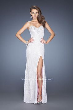 Glamorous lace gown with a sweetheart neckline and side slit. The lining is colored, and neckline is adorned with rhinestones and pearls. Back zipper closure.  La Femme Prom - 20165