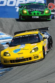 Corvette ZR1 in the Laguna Seca corkscrew followed by a Porsche 911 GT3. - LGMSports.com