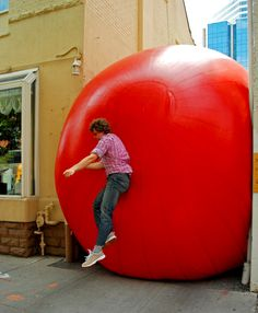 Kurt Perschke is an artist who created The RedBall Project, a public art installation that involves a giant — you guessed it — red ball, that is inflated in and around major public spaces. It provides its audience with a moment of spontaneity and whimsy, providing a soft, bouncy contrast from the often rigid, hard surfaces of buildings and streets.