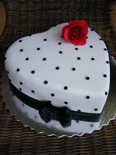 Dotted heart cake. Cute but I'd want a pink heartwith choc & strawberry fillings!