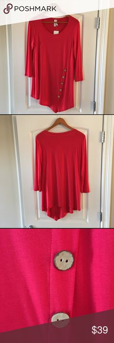 """Red Knit Asymmetrical Tunic NWT Brenda's red tunic Size Small. Scoop neck. Asymmetrical hemline. Five decorative wood buttons on the front. Super soft 95% rayon, 5% spandex. Perfect with leggings or jeans. Kept in a smoke free home. Laying flat, about 36"""" from armpit to armpit, about 33"""" long to the longest edge in the front below the buttons, sleeves about 191/4"""" long. Made in U.S.A. 🇺🇸 Brenda's Tops Tunics"""