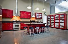 Photography Kitchen. Tri-Digital food photography studio in Boise Idaho. Elegant purple red powder coated steel cabinets with chunky square glass windows.  Photo by: Greg Sims www.moyaliving.com