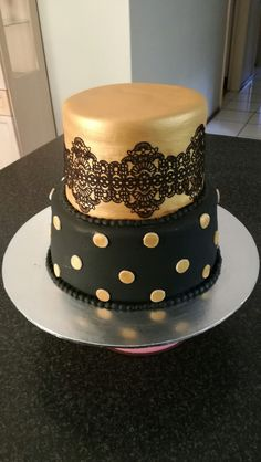 Black and gold lace cake, simple and elegant from CakesbySthabile