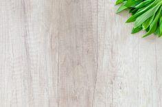 Fresh wood garlic on wood photo by Lukas Blazek (@goumbik) on Unsplash
