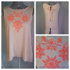 Peach Open Back Top: NWT NEW with tags. Cupio Brand, peach in color with embellishment on front. Tie in back and uneven front to back hem. Thin material. This top is precious. Tops Blouses